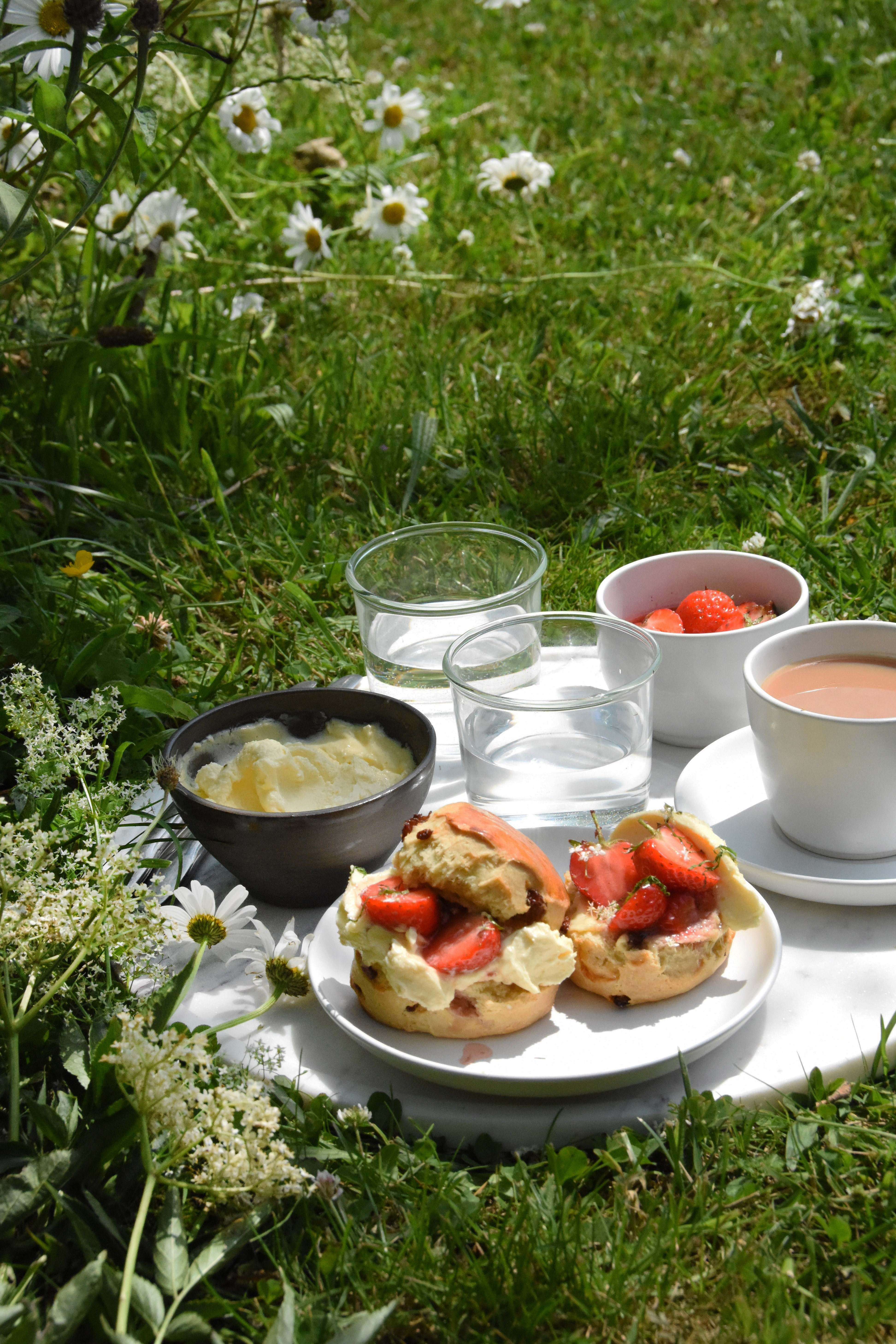 Scones With Clotted Cream And Elderflower Poached Strawberries