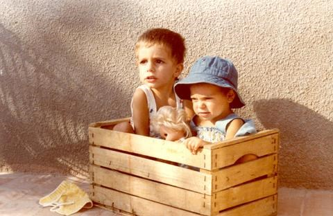 children in a home made box