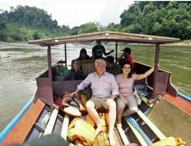 Forestry team members, Sonia Nayar and Andy Grundy, taking a boat ride with the auditor team in Borneo