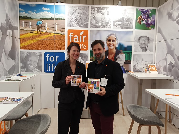 Laurent Lefebvre and a colleague at a conference promoting Fair for Life and For Life in their booth