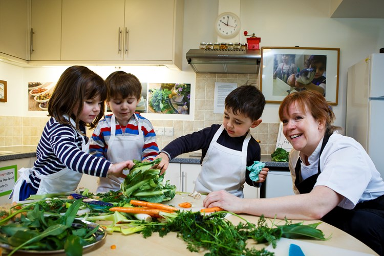 Children cooking with vegetables