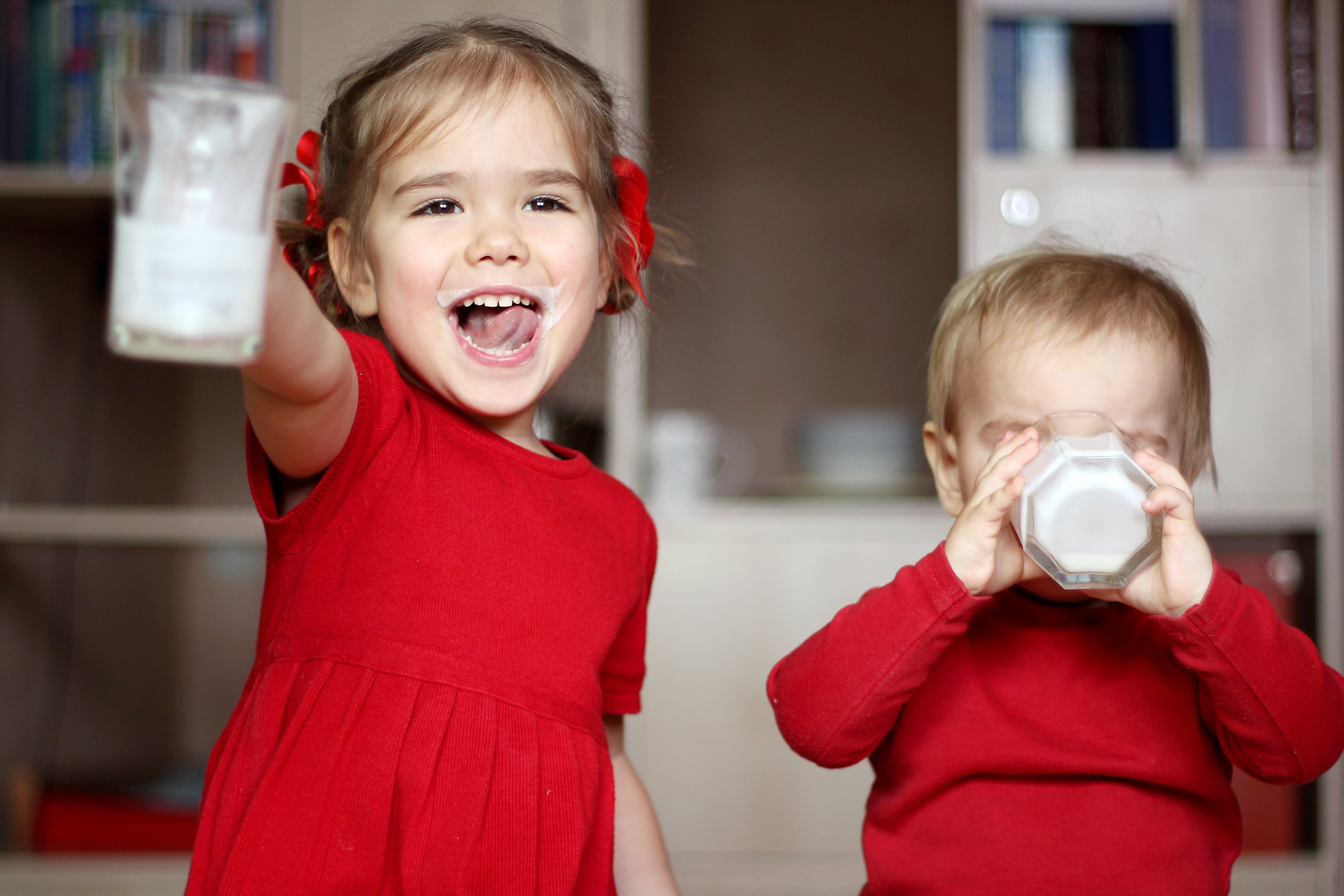 Brother and sister drinking milk.jpg