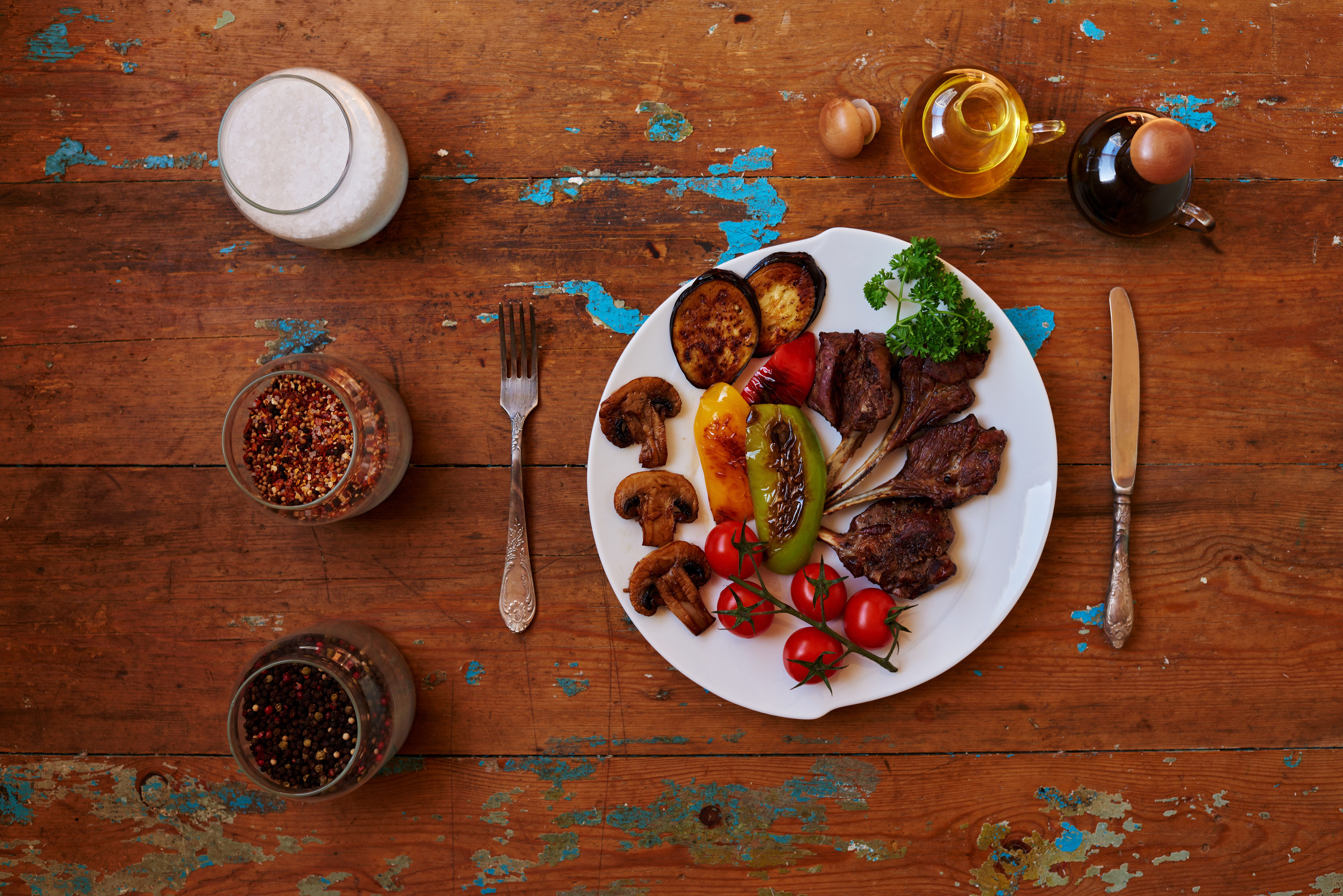 Plate of roasted veg and meat on wooden table.jpg