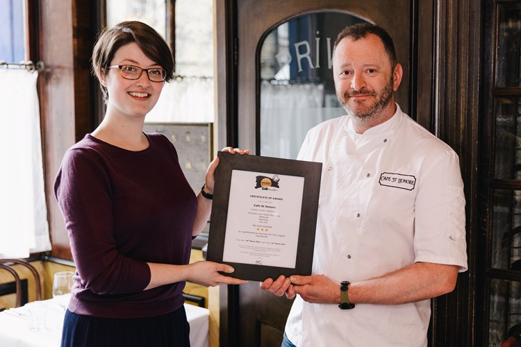 Alison Muirhead (Soil Association) presenting Neil Forbes (Cafe St Honore) with the Organic Served Here 3-star award.