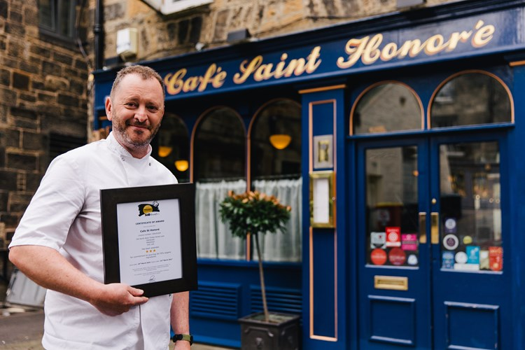 Neil Forbes, Chef Director, with his Organic Served Here 3-star award