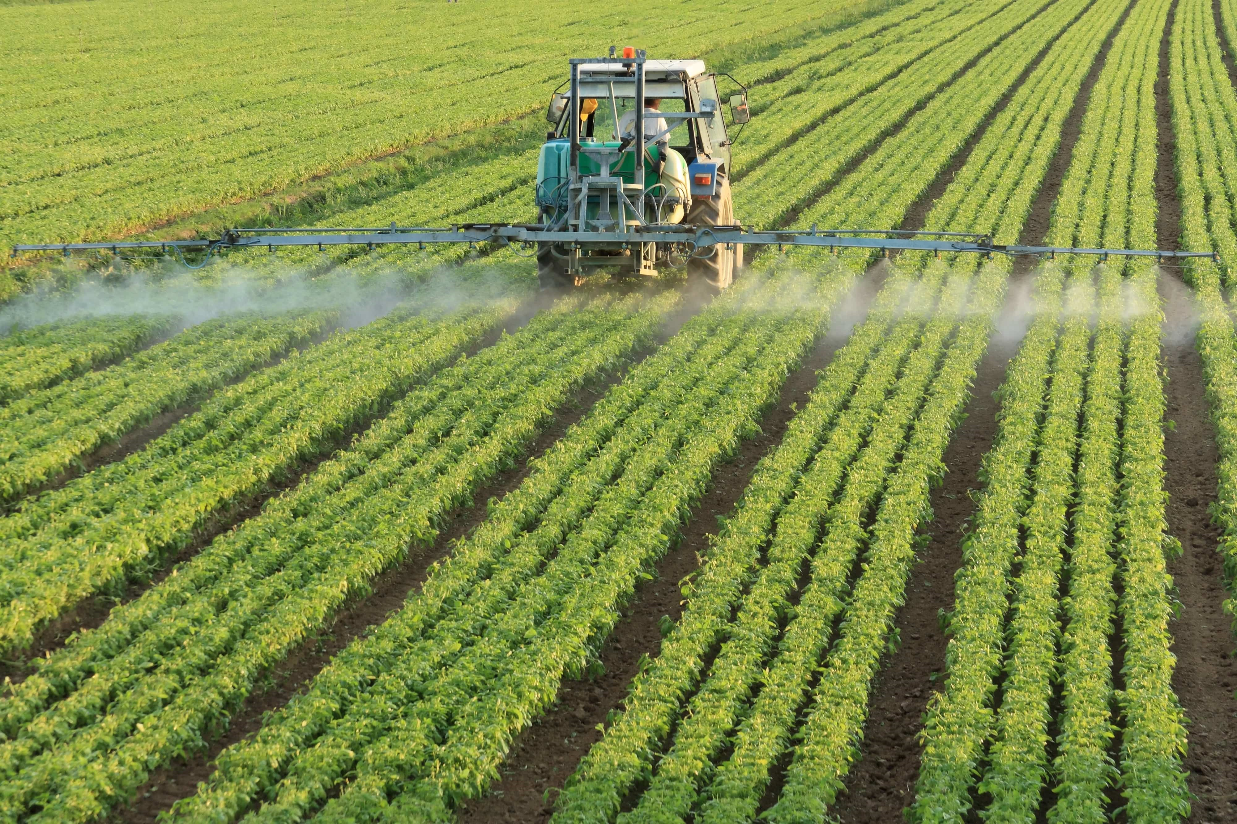 pesticide tractor spray fields.jpg