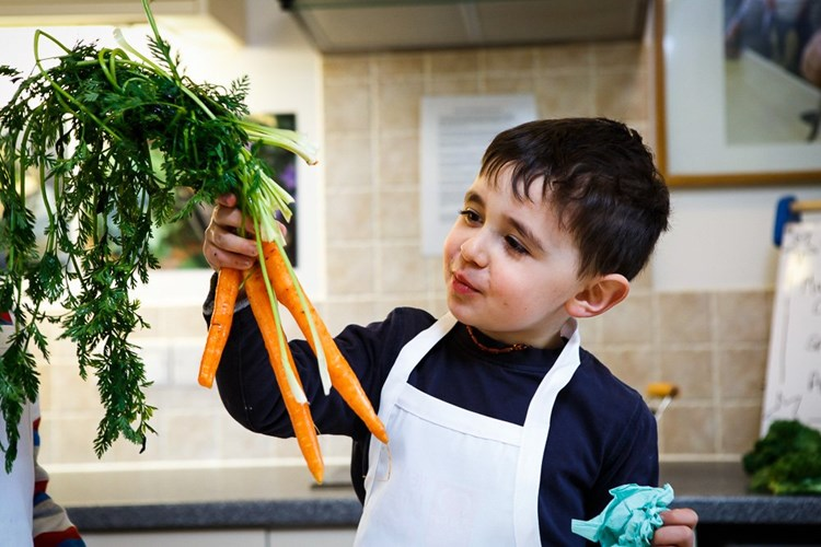 child with a carrot