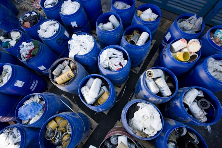 Solid waste sorted in plastic barrels