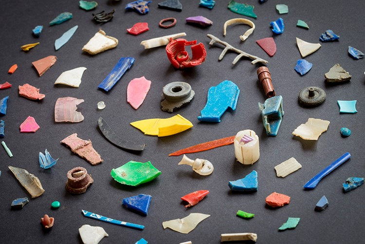 Plastic waste fragments found in a river